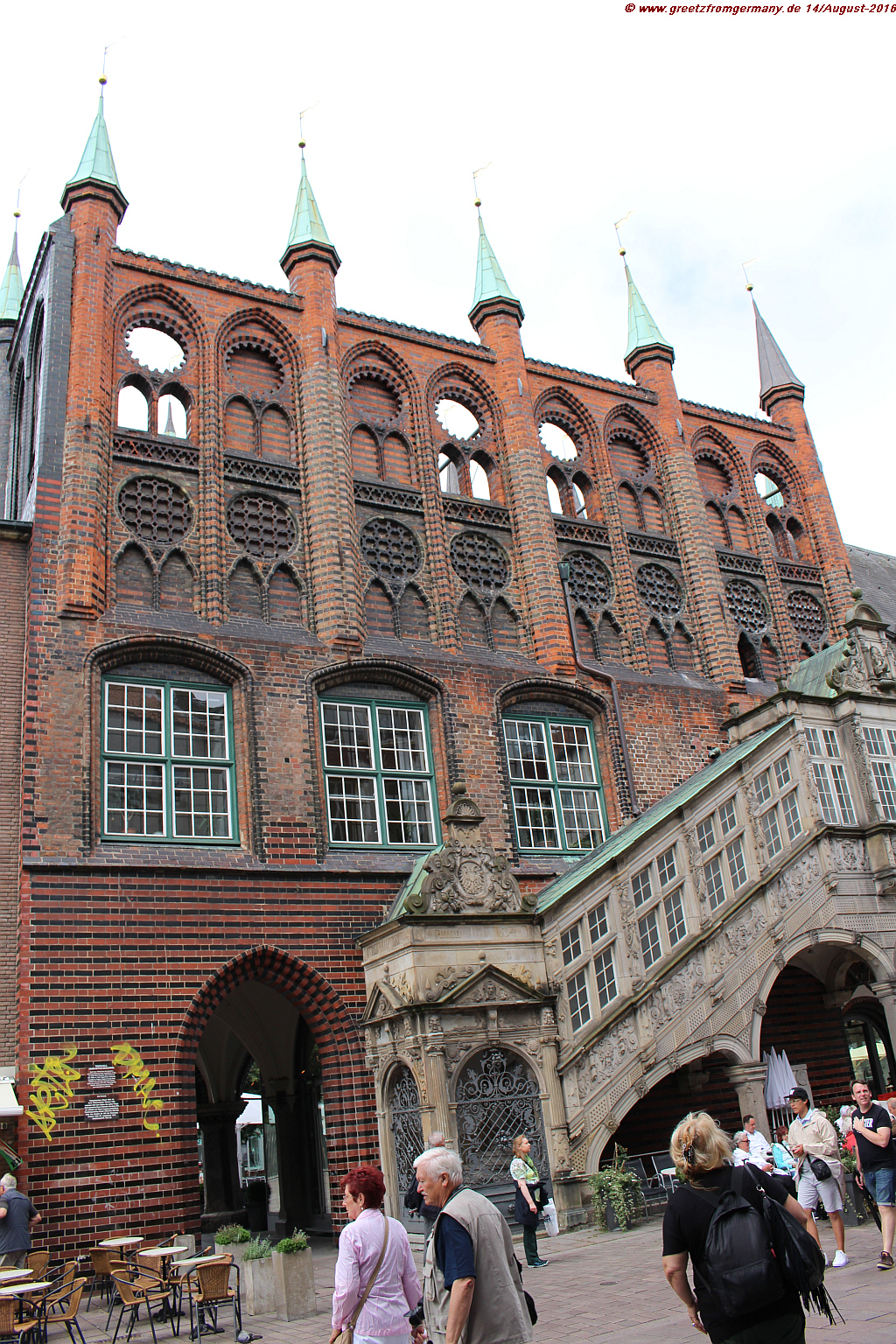 "Lübeck's town hall - a grand building still symbolizing the hightime of merchants' coalition ""Hanse"" and the political benefits that were installed during these times as well - not very far from where people were imprisoned, tortured and killed if their political views were not sufficiently aligned with those of the government."